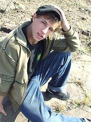 Handsome twink guy posing for the camera outdoors